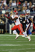Kansas City Chiefs rookie running back Kareem Hunt (27) catches a pass in full stride for a 78 yard touchdown catch and run that gives the Chiefs a 28-27 fourth quarter lead during the 2017 NFL week 1 regular season football game against the New England Patriots, Thursday, Sept. 7, 2017 in Foxborough, Mass. The Chiefs won the game 42-27. (©Paul Anthony Spinelli)