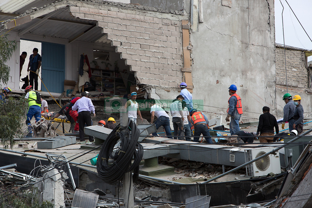 Rescue workers pull a survivor from the rubble of collapsed building in the neighborhood of Condesa, after a quake rattled Mexico City, Mexico on September 19, 2017. The 7.1 magnitude earthquake rocked Central Mexico, killing dozens people and causing serious damage to buildings in the capital. The worst earthquake in the history of Mexico occurred on September 19, 1985, killing nearly 10,000 people. (Photo by Bénédicte Desrus/Sipa USA)