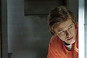 """""""Can Opener"""" -- MacGyver is tasked to go undercover as an inmate in a maximum security prison to break out El Noche, a notorious drug kingpin, using only batteries and salt, and track him to his cartel\'s secret location and dismantle it, on MACGYVER, Friday, Nov. 4 (8:00-9:00 PM, ET/PT) on the CBS Television Network. Pictured: Lucas Till  Photo: Jace Downs/CBS ©2016 CBS Broadcasting, Inc. All Rights Reserved"""