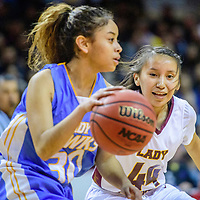 Dulce Hawk Caitlin Duncan (30), left, is shadowed by Tohatchi Cougar Sherika Watchman (44) in a District 3A quarterfinal at the Santa Ana Star Center in Rio Rancho Tuesday.