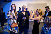 WINNER OF THE PRIZE; JIM GOLDBERG PHOTOGRAPHED BY HIS  DAUGHTER RUBY GOLDBERG, ( RIGHT) The Photographers' Gallery Deutsche Borse Photography prize 2011.  Ambika P3. Baker St. London. 26 April 2011.  -DO NOT ARCHIVE-© Copyright Photograph by Dafydd Jones. 248 Clapham Rd. London SW9 0PZ. Tel 0207 820 0771. www.dafjones.com.