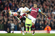 Dimitri Payet of West Ham United and Timothy Fosu-Mensah of Manchester United compete for the ball. The Emirates FA cup, 6th round replay match, West Ham Utd v Manchester Utd at the Boleyn Ground, Upton Park  in London on Wednesday 13th April 2016.<br /> pic by John Patrick Fletcher, Andrew Orchard sports photography.