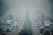 Cars on Interstate 80 drive through the California wildfire smoke in Vacaville on Monday, Aug. 24, 2020.