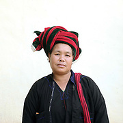 Portrait of a PaO ethnic minority woman at the PaO National Day on 24th March 2016 in Kayah State, Myanmar. The PaO origin story states that they are derived from a shaman, Zawgyu, and a female dragon so the women fashion their turban to resemble a dragons head