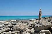 Stone sculpture on Llevant beach, Formentera, Balearic Islands, Spain