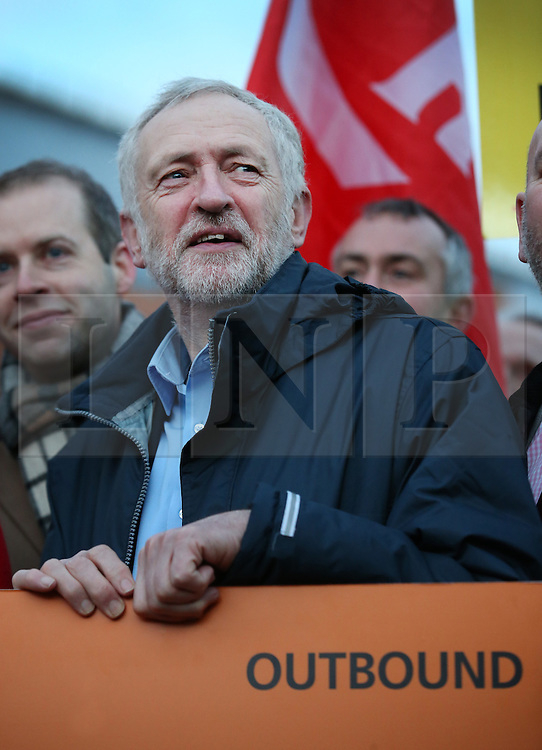 © Licensed to London News Pictures. 04/01/2016. London, UK. Labour leader Jeremy Corbyn stands behind a giant outbound rail ticket as he joins demonstrators at King's Cross station calling for lower rail fares. Photo credit: Peter Macdiarmid/LNP