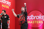 Jonny Clayton wins his quarter final tie against James Wade and celebrates during the PDC Ladbrokes Masters 2021 at Marshall Arena, Milton Keynes, United Kingdom on 31 January 2021.