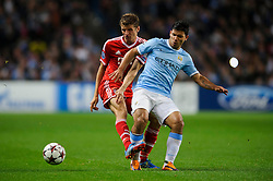 Bayern Midfielder Thomas Muller (GER) is tackled by Man City Forward Sergio Aguero (ARG) during the second half of the match - Photo mandatory by-line: Rogan Thomson/JMP - Tel: Mobile: 07966 386802 - 02/10/2013 - SPORT - FOOTBALL - Etihad Stadium, Manchester - Manchester City v Bayern Munich - UEFA Champions League Group D.