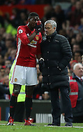 Paul Pogba of Manchester United talks to Jose Mourinho manager of Manchester United during the English Premier League match at Old Trafford Stadium, Manchester. Picture date: December 11th, 2016. Pic Simon Bellis/Sportimage