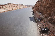 A traveler cycling from the city of Aswan to the Aswan High Dam leaves his bicycle in the shade while taking a short break on the hot journey through desert landscape east of the Nile River. (April 2, 2010)
