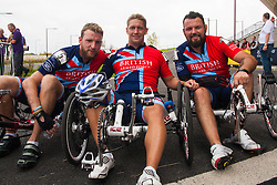 Queen Elizabeth Olympic Park, London. September 13th 2014. Having crossed the finish line together, in the Recumbent IRecB1category, Robert Cromey-Hawke (C), John-James Chalmers (L) and Paul Vice (R) pose for a picture as wounded servicemen and women from 13 different countries compete for sporting glory during the cycling competition at the Invictus Games.