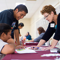 100912       Brian Leddy<br /> Liz Sparks of the Department of the Interior speaks with Dominic Thompson and Roman Foster of Wingate High School during the Crazy Cash City Reality Fair Tuesday. The fair aimed to teach students basic budgeting and financial skills.