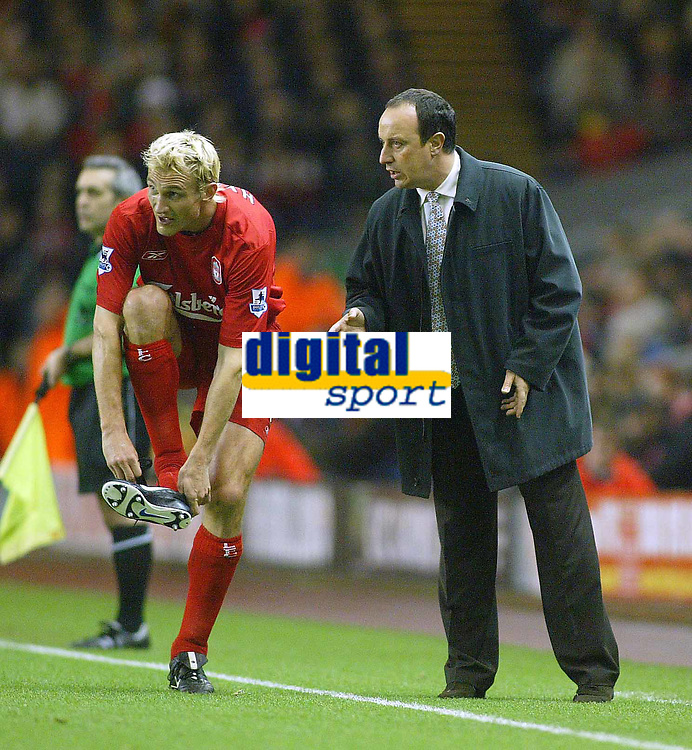 14/12/2004 - FA Barclays Premiership - Liverpool v Portsmouth - Anfield, Liverpool<br />Liverpool's manager Rafael Benitez gives instructions to Sami Hyypia as he puts his boot back on.<br />Photo:Jed Leicester/Back Page Images