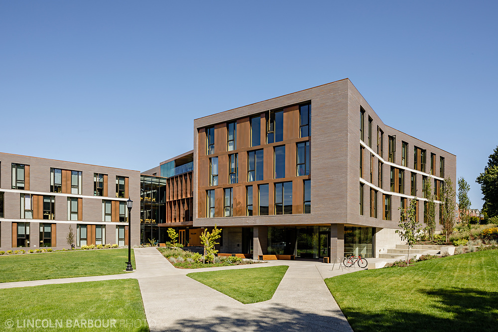 A horizontal view of Trillium Residence Hall on a beautiful day with blue skies overhead.