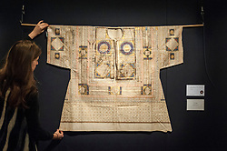 © Licensed to London News Pictures. 02/10/2015. London, UK. A Sotheby's employee shows an Ottoman talismanic shirt from 1583 (est. £60k - 80k) at the preview of Indian and Islamic Art Week at Sotheby's which runs from 2 to 7 October.  Photo credit : Stephen Chung/LNP