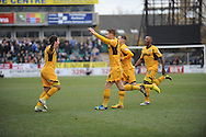 Newport County players celebrate with Danny Crow (L) as he scores his sides 1st goal during the Skybet football league two match, Newport county v Chesterfield at Rodney Parade in Newport, South Wales on Sunday 1st Dec 2013. pic by Jeff Thomas, Andrew Orchard sports photography,