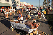 Los Angeles, California - Venice Beach Boardwalk with massage tables on a Sunday morning.