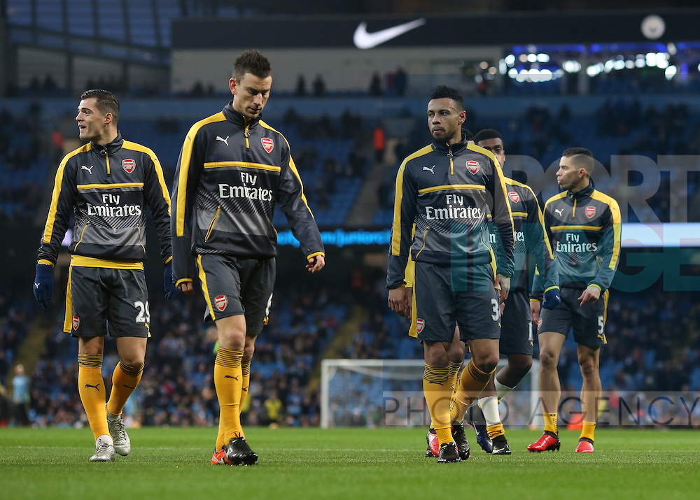 Arsenal players warm up before the English Premier League match at the Etihad Stadium, Manchester. Picture date: December 18th, 2016. Picture credit should read: Simon Bellis/Sportimage