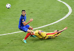 Florin Andone of Romania is fouled by Adil Rami of France  - Mandatory by-line: Joe Meredith/JMP - 10/06/2016 - FOOTBALL - Stade de France - Paris, France - France v Romania - UEFA European Championship Group A