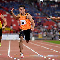 Chong Wei Guan (#45, center) of Singapore Sports School finishes first with a timing of 11.06s in the A Division boys' 100m final. (Photo © Eileen Chew/Red Sports)
