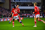 Jacob Brown of Barnsley (33) scores a goal and celebrates with Dimitri Cavaré of Barnsley (12) and Cameron McGeehan of Barnsley (8) to make the score 1-0 during the EFL Sky Bet League 1 match between Barnsley and Bradford City at Oakwell, Barnsley, England on 12 January 2019.
