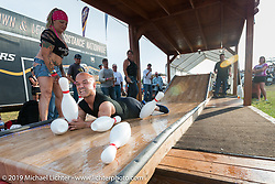 """""""Short Sleave Sampson"""" of New York at his """"Midget Bowling"""" booth at the Buffalo Chip Campground during the annual Sturgis Black Hills Motorcycle Rally. SD, USA. August 6, 2014.  Photography ©2014 Michael Lichter."""
