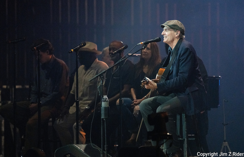 James Taylor performs at BB&T Pavilion in Camden, New Jersey. Jackson Browne and Taylor are on tour together. Taylor joined Browne on stage towards the end of his set to sing The Pretender, among others. Browne returned the favor at the end of Taylor's set. Tylor's son, Henry, is touring with the All Star Band.