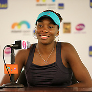Venus Williams of the United States speaks with the media after her victory over Caroline Wozniacki of Denmark during the Miami Open tennis tournament at Crandon Park on Monday, March 30, 2015 in Key Biscayne, Florida. (AP Photo/Alex Menendez)