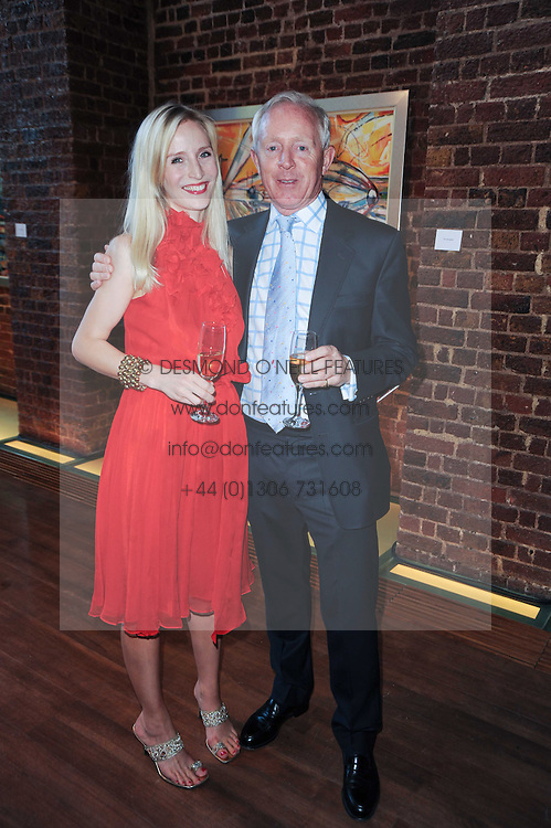 SIMON BREWER and RUTH POWYS Director of the Elephant Family at a private view of Sacha Jafri's paintings entitled 'London to India' held in aid of The Elephant Family charity at 23 Macklin Street, Covent Garden, London on 3rd June 2010.