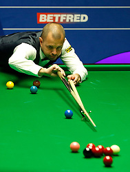 Barry Hawkins in action against Stephen Maguire, on day twelve of the Betfred Snooker World Championships at the Crucible Theatre, Sheffield.