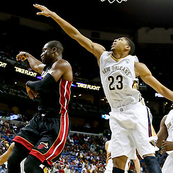 Oct 23, 2013; New Orleans, LA, USA; Miami Heat shooting guard Dwyane Wade (3) passes as New Orleans Pelicans power forward Anthony Davis (23) defends during the second half of a preseason game at New Orleans Arena. The Heat defeated the Pelicans 108-95. Mandatory Credit: Derick E. Hingle-USA TODAY Sports
