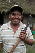 Justino Peck, 49, Mopan Mayan cacao grower from San Jose, Toledo, smiles in front of his home. Mr. Peck served as TCGA chairman from 1992 to 1997, once again from 2003 to 2010, and is currently the TCGA's liaison officer. Toledo Cacao Growers' Association (TCGA), San Jose, Toledo, Belize. January 25, 2013.