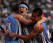 Liam Boylan-Pett, center, is embraced by Jonah Rathbun, left, and Mike Mark after anchoring Columbai to victory in the Championship of America 4 x 800-meter relay in 7:22.64 in the 113th Penn Relays at the University of Pennsylvania's Franklin Field in Philadelphia, Pa. on Saturday, April 28, 2007. It was Columbia's first Penn win since 1938 and first in the 4 x 800 since 1933.