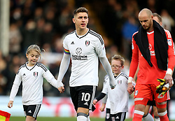 Fulham's Tom Cairney with a rainbow coloured captain's armbands to show support for the Stonewall Rainbow Laces campaign for LGBT