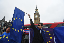 August 21, 2017 - London, England, United Kingdom - Anti Brexit demonstrators are seen waving European Union flags against the backdrop of the Big Ben, London on August 21, 2017. The UK government has set out proposals to ensure trade in goods and services can continue on the day the UK leaves the EU in March 2019. (Credit Image: © Alberto Pezzali/NurPhoto via ZUMA Press)
