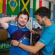 24 hour charity table tennis play at Brighton Table Tennis club. The event is to raise money for solar panels and is themed purple and in the name of the late artist Prince who donated money to solar panels. Photographed for the charity 10:10