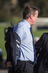 © Licensed to London News Pictures.06/04/15 Bristol. UK. Prime Minister and Leader of the Conservative Party, David Cameron, removes his jacket on one of the hottest days of the year after making a speech at Bristol & Bath Science Park at Emerson's Green in South Gloucestershire today 6th April 2015. Photo credit : James Knight/LNP