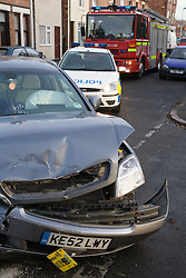 Emergency services attending an road traffic accident in a side street in Nottingham,