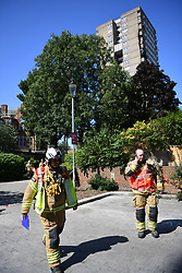 © Licensed to London News Pictures. 23/08/2019. London, UK.  A fire broke out on the 12th floor of a tower block very close to the devastating inferno that destroyed Grenfell Tower killing 72 people two years ago. Ten engines and 70 firefighters brought the blaze under control which gutted the apartment and spread externally along satellite cables. Residents of Markland House self evacuated and commented that no fire alarms were heard in the building.  Photo credit: Guilhem Baker/LNP