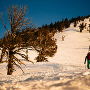 Kim Havell climbs up Glory for some early season skiing in the Tetons near Wilson, Wyoming.