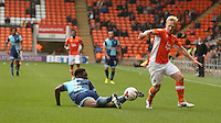 Blackpool's Mark Cullen gets past Wycombe Wanderers' Anthony Stewart<br /> <br /> Photographer Stephen White/CameraSport<br /> <br /> Football - The EFL Sky Bet League Two - Blackpool v Wycombe Wanderers - Saturday 20 August 2016 - Bloomfield Road - Blackpool<br /> <br /> World Copyright © 2016 CameraSport. All rights reserved. 43 Linden Ave. Countesthorpe. Leicester. England. LE8 5PG - Tel: +44 (0) 116 277 4147 - admin@camerasport.com - www.camerasport.com