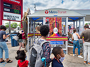 """12 JUNE 2020 - MINNEAPOLIS, MINNESOTA: A bus shelter turned into a part of the impromptu community memorial for George Floyd at the corner of 38th Street and Chicago Ave. in Minneapolis. The intersection is informally known as """"George Floyd Square"""" and is considered a """"police free zone."""" There are memorials to honor Black people killed by police and people providing free food at the intersection. Floyd, an unarmed Black man, was killed by Minneapolis police on May 25 when an officer kneeled on his neck for 8 minutes and 46 seconds. Floyd's death sparked weeks of ongoing protests and uprisings against police violence around the world.          PHOTO BY JACK KURTZ"""