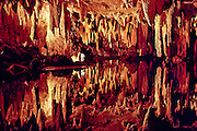 Discovered in 1878, Luray Caverns in Virginia has a spactacular array of both stalagtites (attached to the roof) and stalagmites (rising from the ground).  However, in this view, only stalagtites are present, each perfectly reflected in a shallow pool of water below.  The formations are formed when a solution of calcium carbonate releases carbon dioxide, resulting in precipitation of lime.  The crystallized calcite accumulates at the rate of one cubic inch every 120 years.