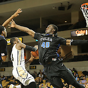 ORLANDO, FL - DECEMBER 31:  Daiquan Walker #4 of the UCF Knights drives to the net against Shaquille Harrison #3 and D'Andre Wright #40 of the Tulsa Golden Hurricane during an NCAA basketball game at the CFE Arena on December 31, 2014 in Orlando, Florida. (Photo by Alex Menendez/Getty Images) *** Local Caption *** Daiquan Walker; Shaquille Harrison; D'Andre Wright