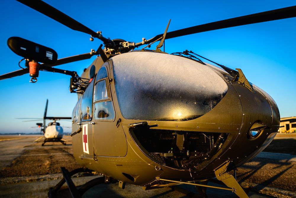 "UH-72 ""Lakota"" MEDEVAC on the flight line during a cold morning sunrise"