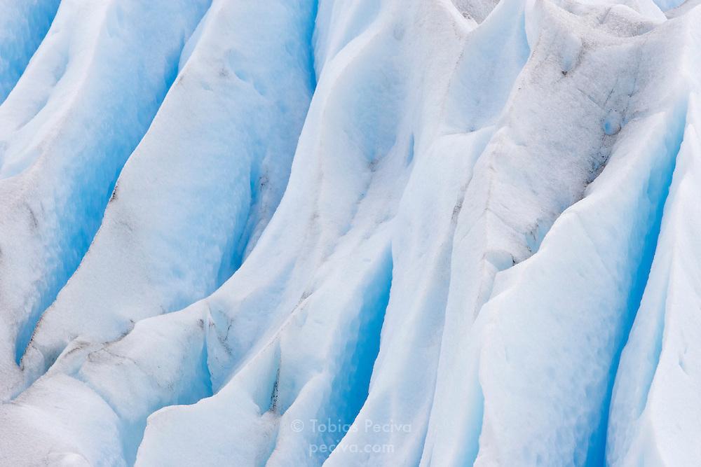 Cracks in the surface ice of the Perito Moreno Glacier. The glacier is a popular hiking destination in Los Glaciares National Park, Argentina.