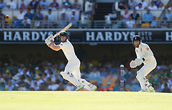 Australia's Shaun Marsh plays a shot as Jonny Bairstow looks on during day two of the Ashes Test match at The Gabba, Brisbane.