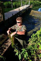 UK ENGLAND WILTSHIRE 26JUN08 - River keeper John Hounslow opens a gate before cutting weeds in the riverbed of the Kennet near Stichcoombe in rural Wiltshire, western England...jre/Photo by Jiri Rezac / WWF UK..© Jiri Rezac 2008..Contact: +44 (0) 7050 110 417.Mobile:  +44 (0) 7801 337 683.Office:  +44 (0) 20 8968 9635..Email:   jiri@jirirezac.com.Web:     www.jirirezac.com..© All images Jiri Rezac 2008 - All rights reserved.