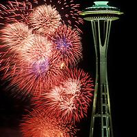 USA, Washington, Seattle, 4th of July fireworks illuminate sky behind Space Needle