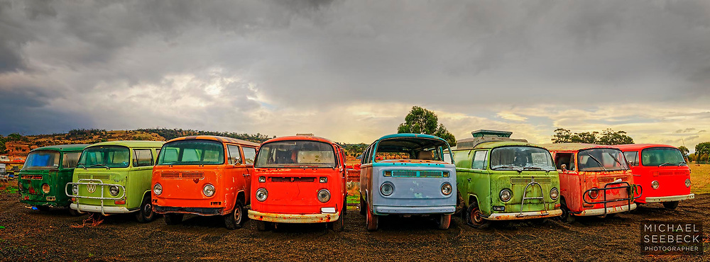 A panoramic photograph of a collection of old kombie campervans awaiting restoration.<br /> <br /> Code: AADE0001<br /> <br /> Limited Edition of 125 Prints